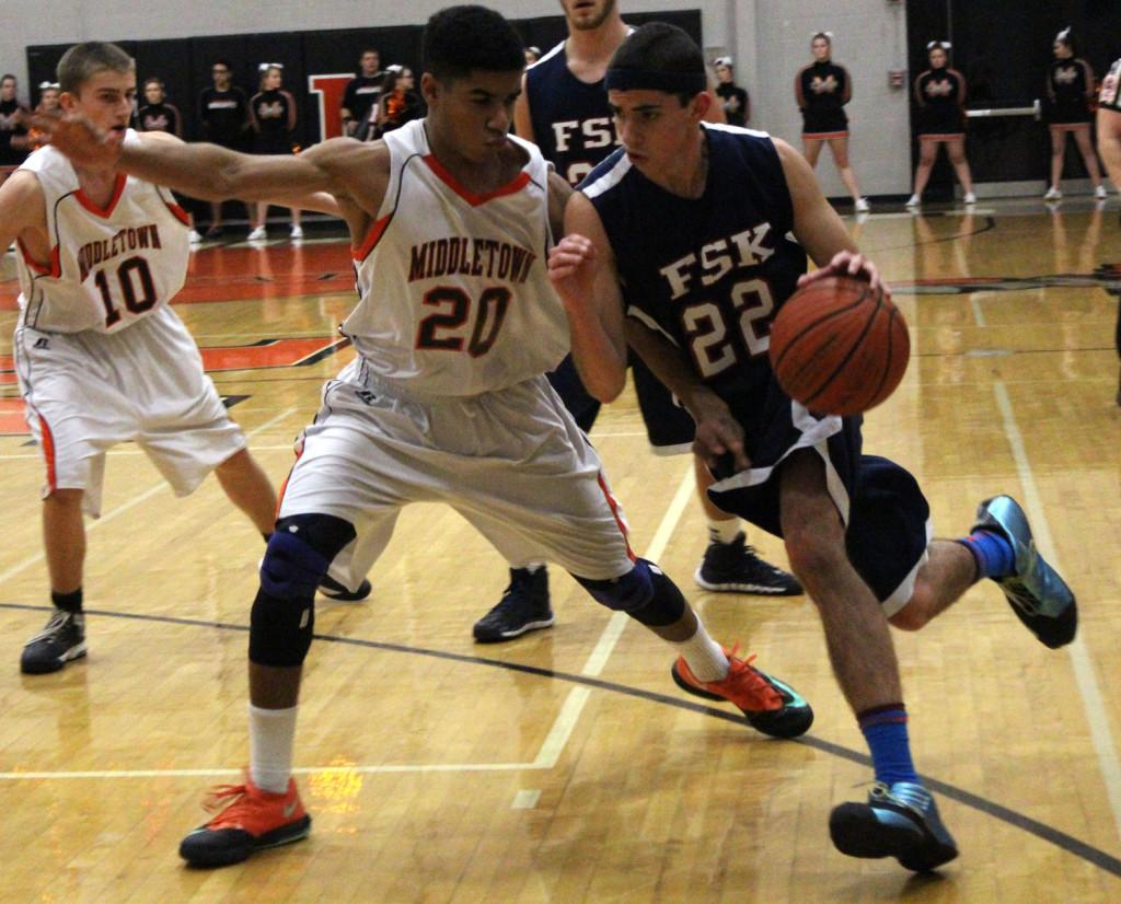 Middletown junior Cedric Ayenu (#20) guards an FSK defender during the Knights 50-49 win over the Eagles.