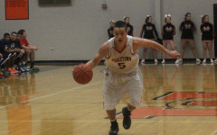 Senior Tim Schumacher dribbles down the court on a fast break