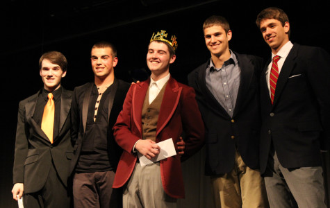 "Evich ""freezes"" the other competitors in the Mr. Middletown competition"