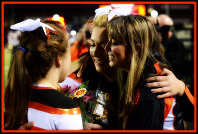 Coach Bolt hangs up her pompoms