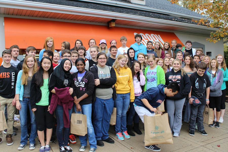 Sean Haardt's government students pose for a picture after a busy day of volunteering.