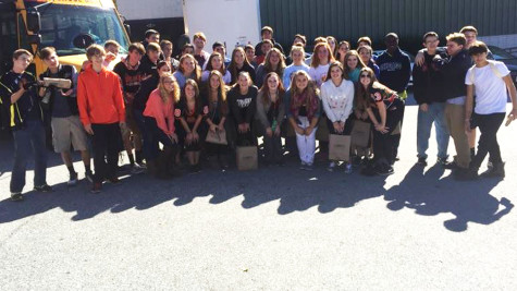 Sean Haardt's students pose for a picture after working at SERRV