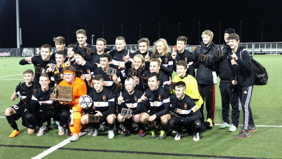 The Middletown boys varsity soccer team lines up for a quick group picture after their state championship win against La Plata.