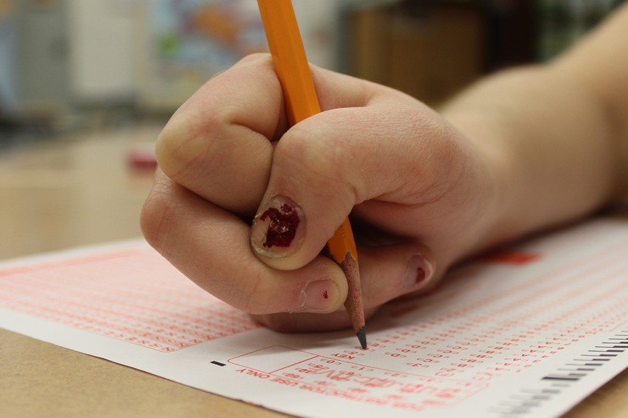 A student takes a standardized test during second block.