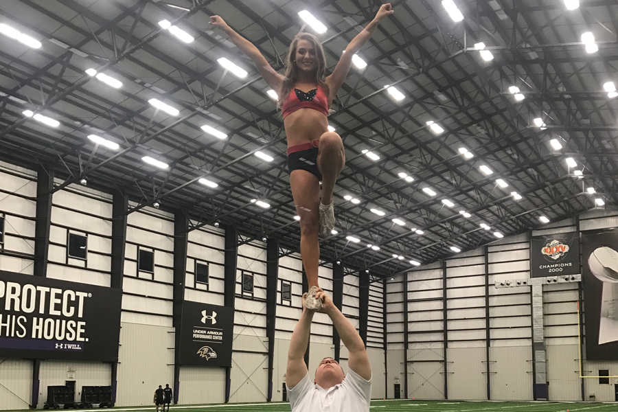 Couper+is+one+of+six+new+male+recruits+for+the+Baltimore+Ravens+cheer+team.+He+practices+stunts+twice+a+week+with+fellow+teammates+for+the+upcoming+season.+