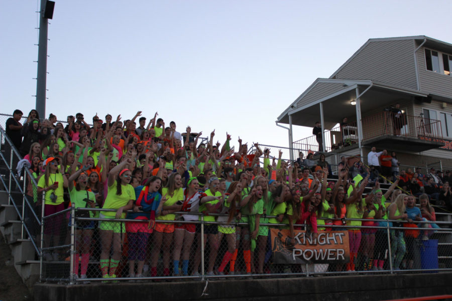 The+student+section+at+MHS+is+electric+on+neon+night.