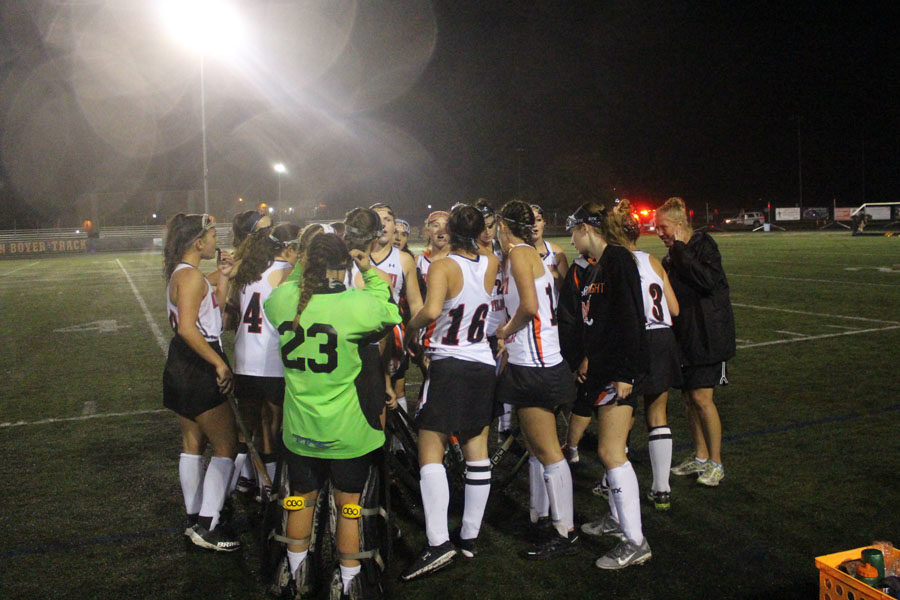 Knights players huddle during the game to discuss their strategy.