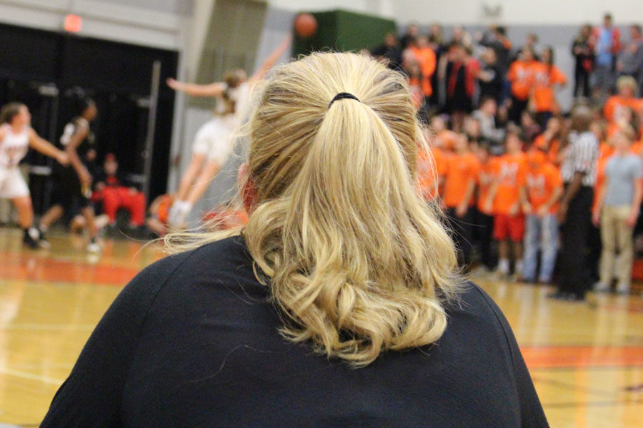 Head+coach+of+the+MHS+basketball+team+Amy+Poffenbarger+watches+the+game.+