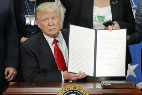 Donald Trump, finishing signing an executive order to give back the Predator Control Laws to Alaska. This executive order was overlooked when he announced that hunters would be allowed to kill elephants in Zimbabwe and bring them back as trophies.