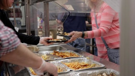 MIddletown staff serve food to those who attended the banquet.