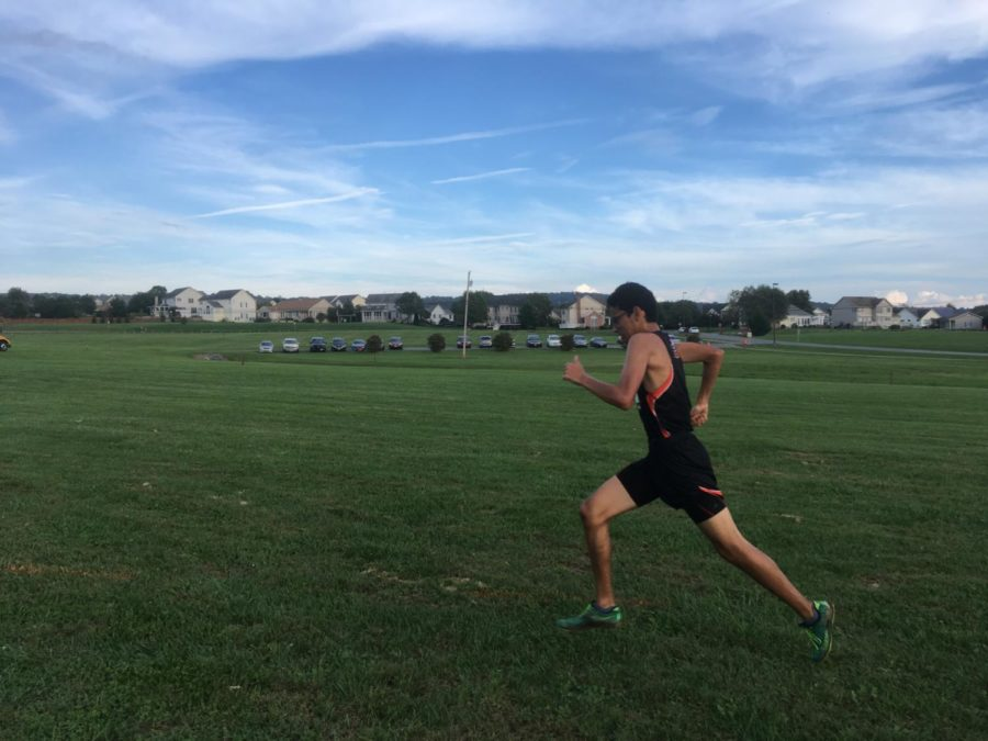 MHS senior Trey Dravvorn races to the finish with the Middletown horizon in the background.