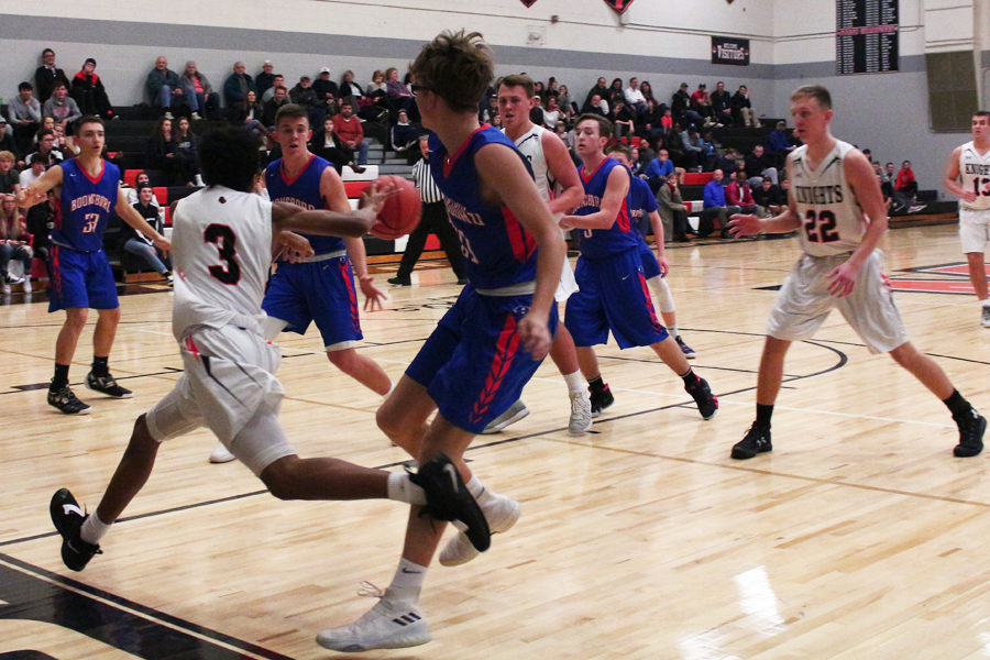 Middletown High School freshman Jalen Huskey passes to his teammate Mason Doody.
