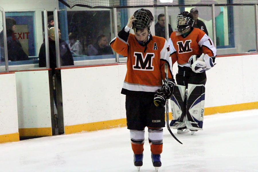 Assistant+captain+Jake+Dziubla+skates+off+the+ice+following+a+7-0+loss+against+Oakdale+in+the+Monocacy+Valley+Hockey+League+championship.+-Photo+by+Ray+Dziubla