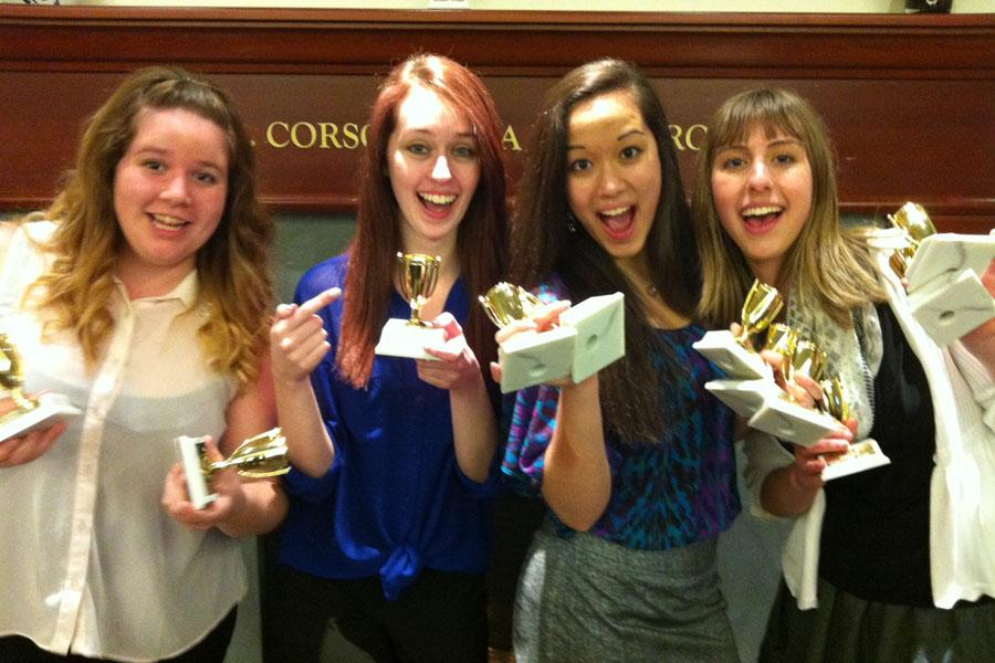 Middletown High School students Samantha Carter, senior, Jessica Molander, junior, Johanna Yee, senior, and Ashlyn Miller, senior, celebrate their accomplishments at the 2013 West Virginia University high school journalism competition on April 12.  The MHS Round Table staffers brought home a total of 12 awards, including five first-place honors. - Staff photo