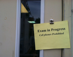 A sign is hung outside of portable four on Wednesday May 15 during the AP United States History Exam. Every year MHS seniors, juniors, and some sophomores take AP exams.