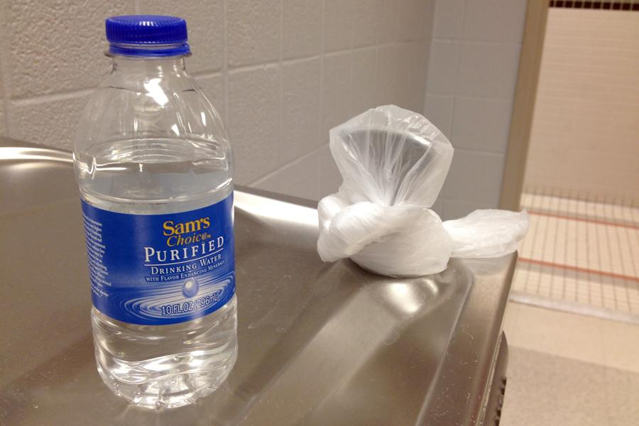 A plastic bottle filled with water from the Middletown High School water system sits atop one of the water fountains that has been closed for drinking.  As precautionary measures after the school water supply was found to be slightly discolored, administrators on Jan. 28 prohibited use of the water fountains, sinks for hand-washing, and water for cooking until tests could be completed. - Photo by Taylor Bushey