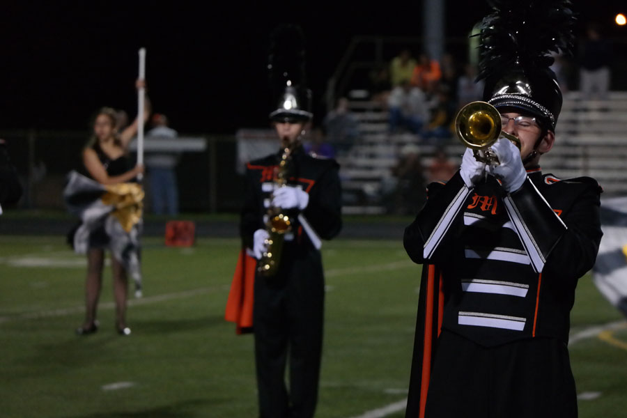 The MHS Marching Knights perform their half-time show at a home varsity football game against Winters Mill.