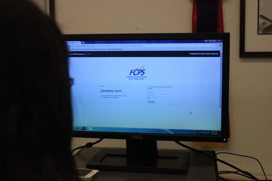 MHS senior Julia Kingsbury attempts to access YouTube, however FCPS has an overreaching block on it. Student's often have to watch videos , that are beneficial to the curriculum, at home which is a waste of time in school and out of school .