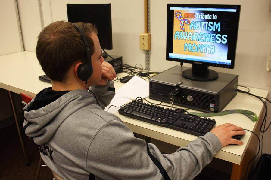 MHS senior Jake Evans works on his continuing coverage of Autism Awareness Month.