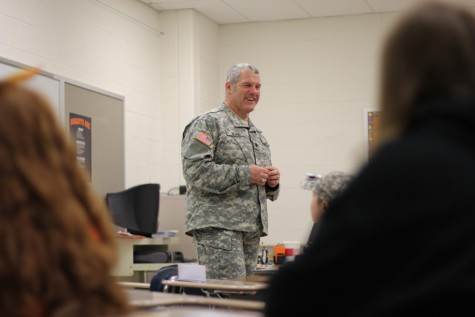 STEM Day presenter tells students about the use of science, technology, engineering, and mathematics in the military.