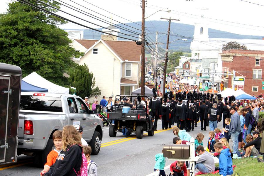 The MHS Marching Knights walk down Main Street getting ready to perform for the Middletown community.
