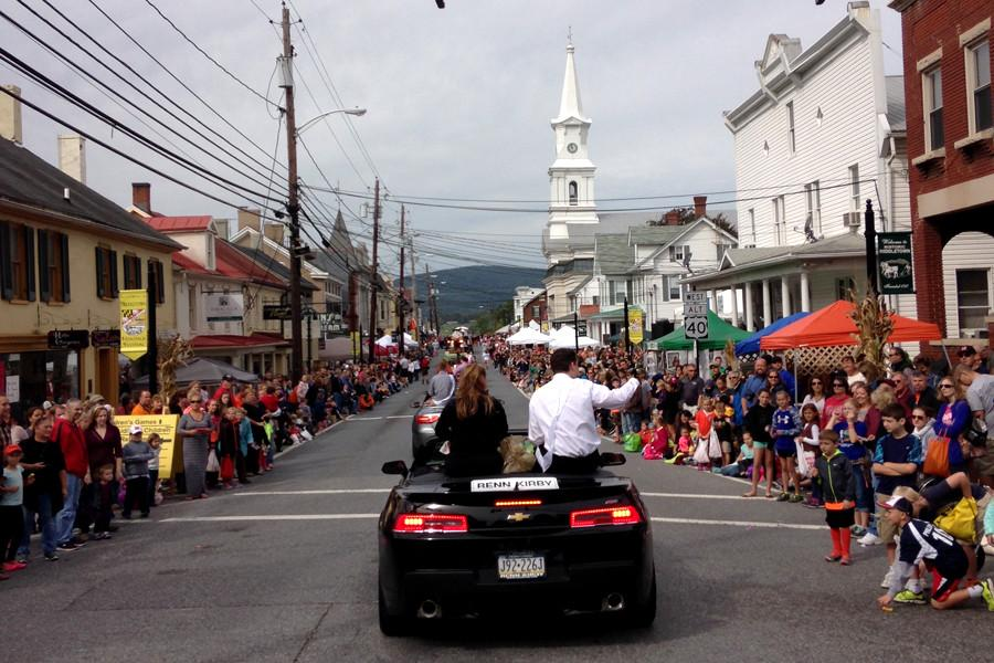 The homecoming court floats down Main Street during the Heritage Day parade.