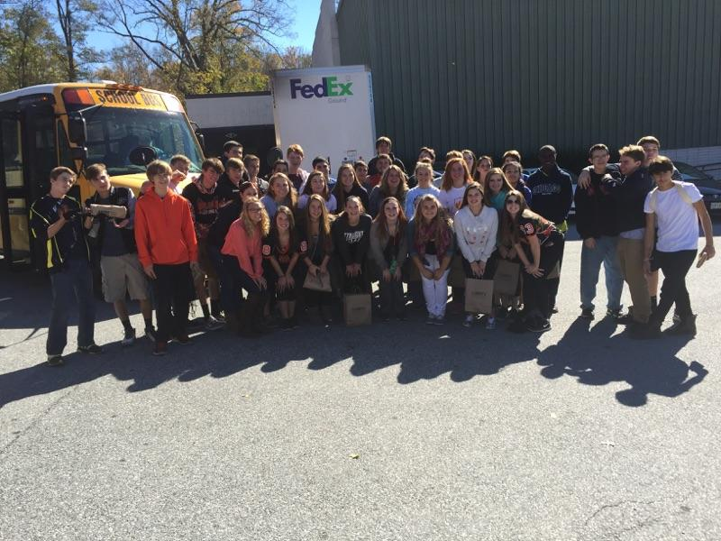 Sean Haardts students pose for a picture after working at SERRV