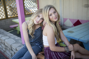 Maddie and Tae pose for photos to be put on their website.
