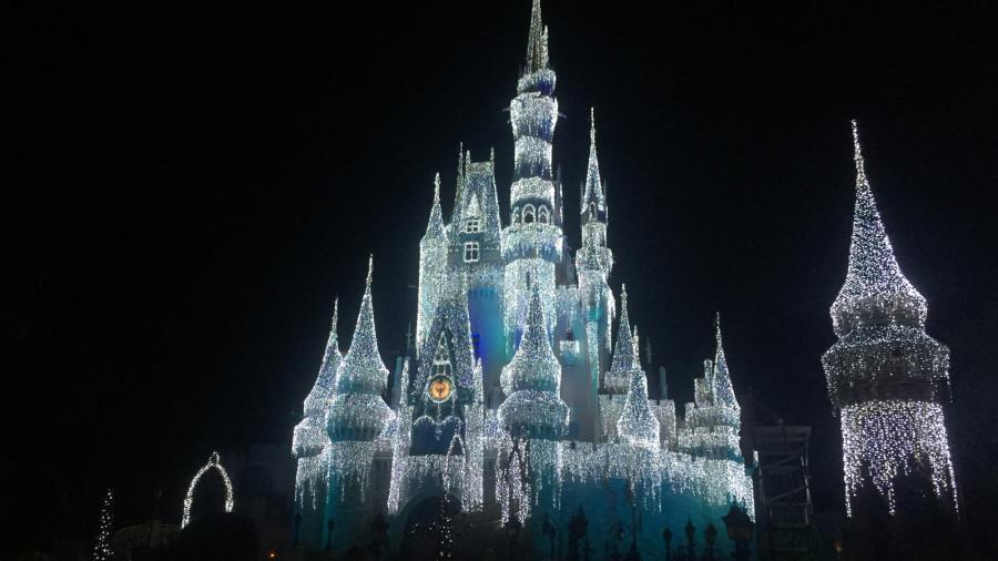 Cinderella's castle lights up during Mickey's Very Merry Christmas party.