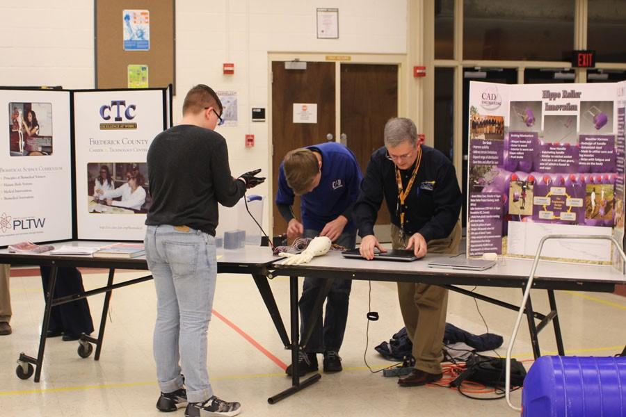 A student visits a class  booth on registration night.