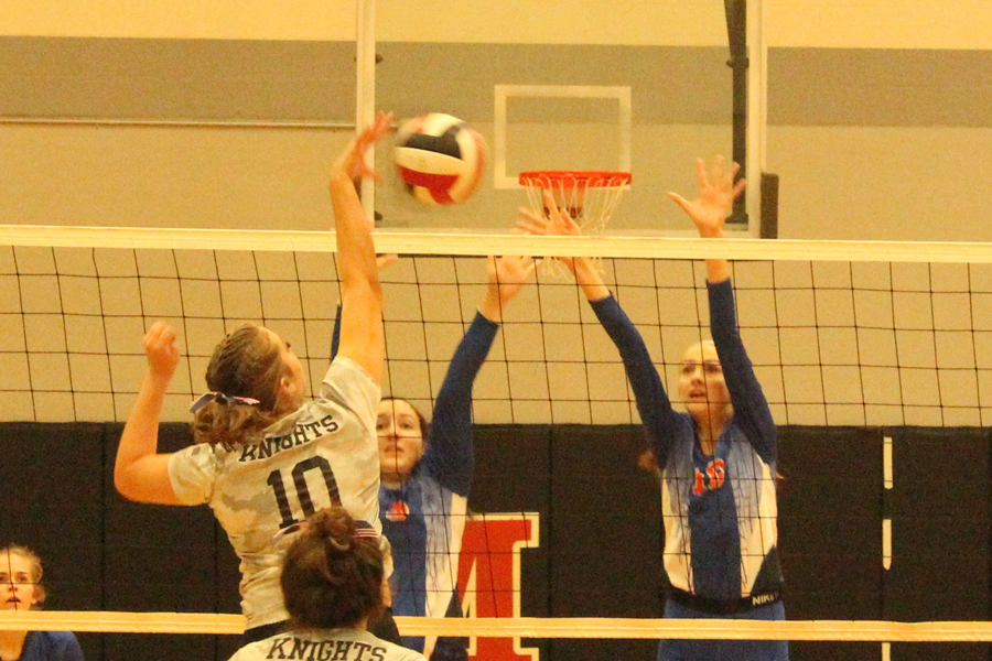 Sydney Wilbur tips the ball right over the net against BHS.
