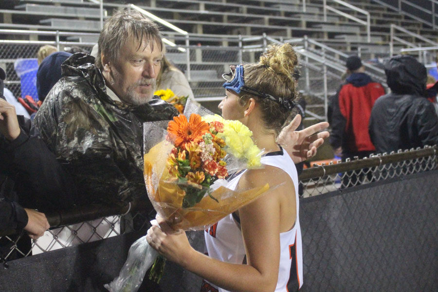 Tess Queen is congratulated after the 3-1 loss to Urbana High School.