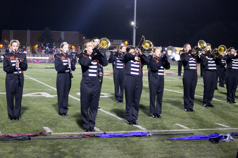 The Marching Knights perform with the MHS dance lien during halftime.