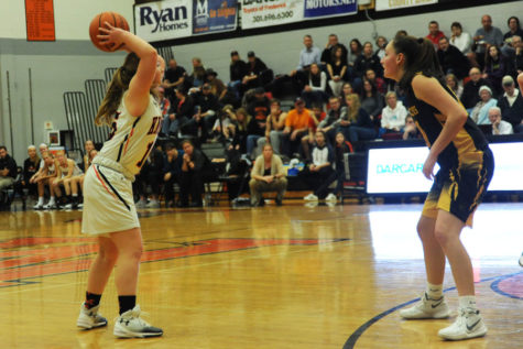 MHS junior Molly Faron attempts a pass against South Carroll High School.