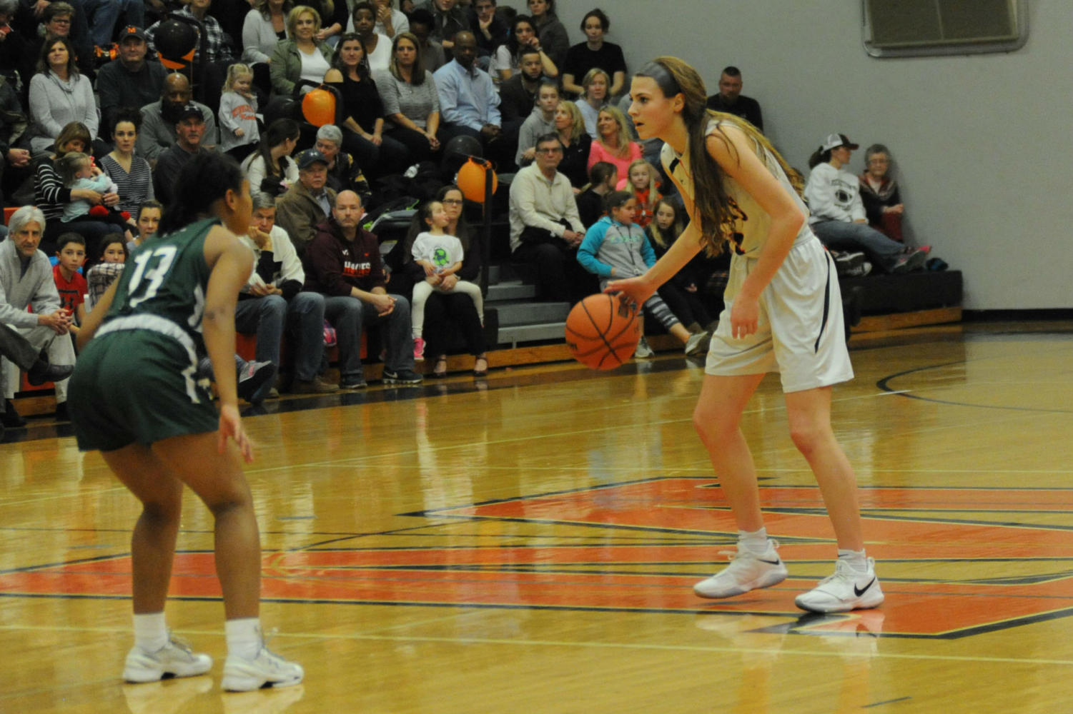 MHS player Saylor Poffenbarger dribbles the ball down the court.