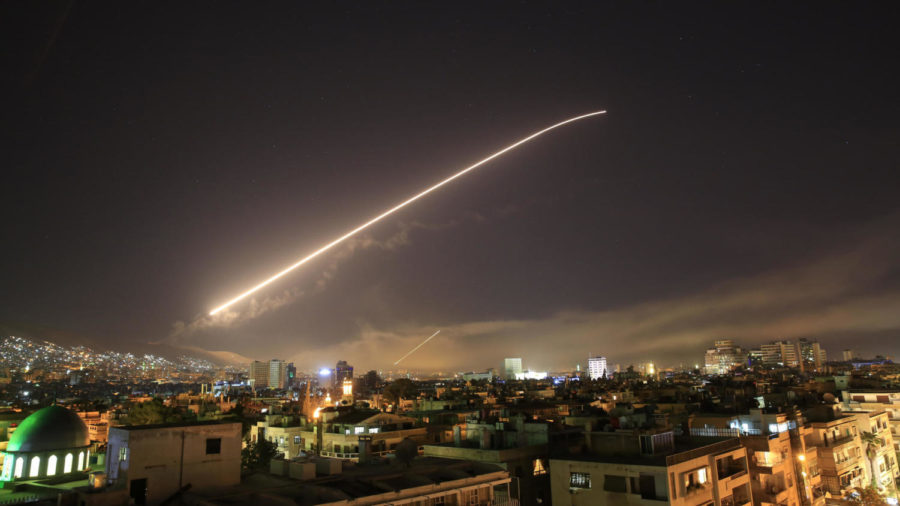 The+Damascus+sky+lights+up+with+missile+fire+as+a+U.S.-led+coalition+launches+an+attack+early+Saturday%2C+targeting+different+parts+of+the+Syrian+capital.