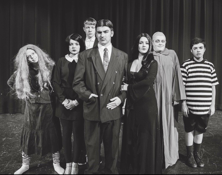 The+Addam%27s+family+poses+for+a+cast+photo.